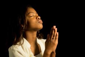 Praying African American Teen